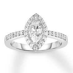 """Say """"yes"""" to a marquise diamond engagement ring, featuring a halo of diamonds and set in 14 karat white gold."""