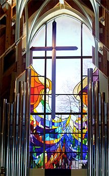 A stained glass window above the entrance way to greet guests and welcome the sun.