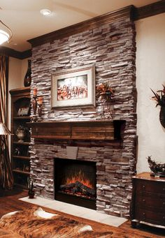 Architectural stone fireplace...how cozy!