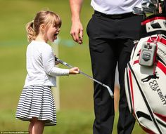 At one point, his cheeky daughter even removed one of the clubs from his bag and stuck her...