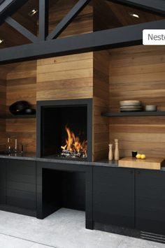 | P | Stylish outdoor kitchen in Black and Cedar Siding