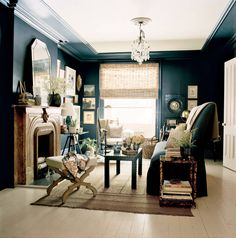 Taken with fall fashion's sumptuous fabrics, deep colors and distressed jewelry, we created a darkly romantic drawing room that fuses stately traditionalism with a lush, literary...