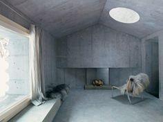 Concrete livingroom at the Refuge house in Switserland