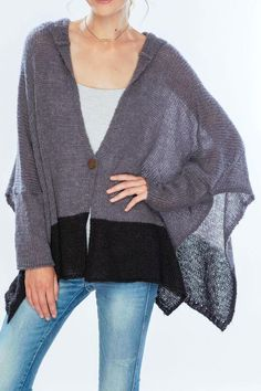The Jemma Hoodie in a combination of steel grey and black is a sweater/poncho with sleeves and ribbed cuffs and a single button closure. Perfect over jeans pants a dress or sweater and skirt! Jemma Hoodie Poncho by Wooden Ships. Cape Cod Massachusetts