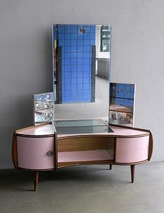 Curved pink formica dressing table