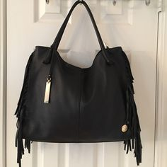Vince Camuto Black Large Leather Fringe Bag Never used.  Leather.  Zip closure.  3 interior pockets (1 zips).  Hang tag.  Gold hardware.  Measures: 15.5x3.5x12x8. Vince Camuto Bags Shoulder Bags