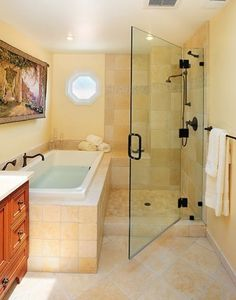 Not my kind of color scheme, but I love how the shower/bath are together...one space to clean!