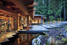 The Douglas-fir timbers of this contemporary home were assembled by Macdonald & Lawrence Timber Framing Ltd. SPJ Lighting created the lanterns based on Brian Hemingway's architectural design and Belltech Electric supplied their internal LED lighting.