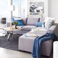 J'adore ce modulaire divan avec les couleurs bleu et gris
