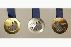 olympics winter 2014 | Medals for the 2014 Winter Olympic Games in Sochi are seen on display ...