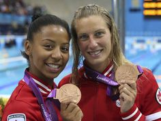 Emilie Heymans and Jennifer Abel, both of Montreal, show off their bronze medals in women's Synchronized 3-metre springboard competition at the 2012 London Olympics, on Sunday, July 29, 2012.