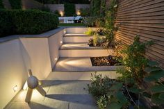 Cool, sleek Blue Grey Granite sawn paving in a contemporary urban garden. Love the lighting and crisp, strong lines. Built by Hammersmith & Chiswick Landscapes. Outdoor Seating Areas, Garden Seating, Outdoor Spaces, Patio Steps, Garden Steps, Rustic Place Cards, Granite Paving, Public Garden, Paving Stones