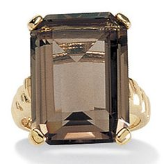 Smokey quartz - love this. NH State Gemstone. I will own this when I am rich and famous... so much classier than diamonds.