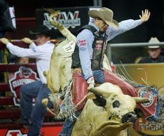 J.W. Harris finished in first place in the bull riding finals of the 2013 River City Rodeo. By: MARK DAVIS/THE WORLD-HERALD
