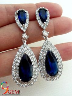 Make a luxurious style statement with our Blue sapphire diamond earrings