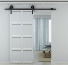 Barn door with black rollers over a single interior door