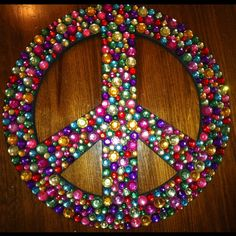 Bling'd Peace Sign. Great project for your teen :) make it large for a statement piece in her new un-babyish room :)
