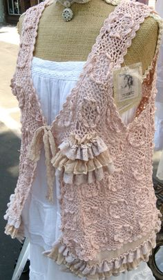 love the color and the style of this Vest - not to sure about the ruffle things but the vest is cute!