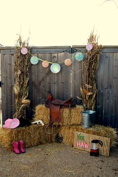 Western party backdrop for photos with saddle and hay bales