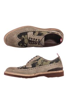 Beige suede brogues with full wing-tip brogue detailing and canvas camouflage-print front and side panels. Taking a new approach to military, Green George's camo brogues are a modern reworking of a footwear classic.