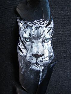 Snow Leopard Feather by JenTheThirdGal