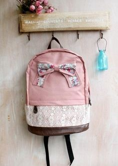 """This backpack with lace around bottom and bow on top.  Sturdy enough and cute for school.  The size:  width: 11""""  height: 16""""-17""""  depth: 5""""-6"""""""