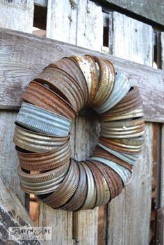 Rusty canning jar lid wreath on outdoor reclaimed wood shed door, via Funky Junk Interiors