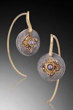 Jenny Reeves: pearl, silver, and gold earrings.