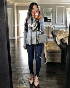 Gray peplum top, plaid scarf, dark skinny jeans, gray bag, and lace up flats | Gray fall outfit