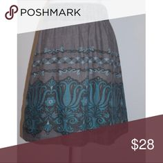 Pretty Free People boho peasant skirt size Medium Boho inspired beautiful Free People brand skirt in gray with turquoise flowers! Flowy and pretty yet casual enough to wear everywhere!                                                Elastic Band waist                                                                                                    Length- knees Free People Skirts