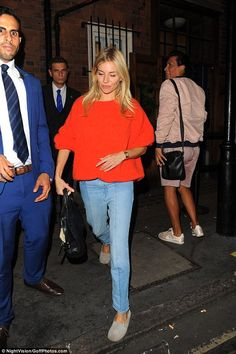 Sienna Miller leaves Apollo theatre in an orange jumper