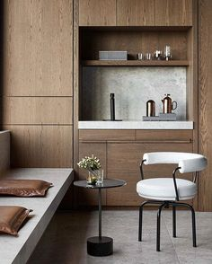 The recently completed offices of @pdg_melbourne by @studiotate have been designed to look more like a home or hotel than a typical workspace. With every last detail considered and a sophisticated mix of textured materials in black, white, tan and walnut tones ~ find out more about this incredible project on the blog today (link in profile).  by @peterclarkephoto  #StudioTate #WorkplaceDesign  #InteriorArchitecture #TDCBlog #thedesignchaser.com