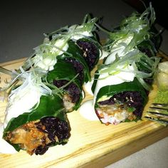 Our Chesapeake Bay Roll is incredible! Fried oyster, black rice, red tobiko, green onion, avocado, garlic aoli+ wrapped in collard green!