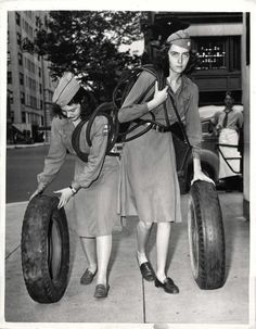 1942- 16-year-old girls of the American Women's Voluntary Service go house-to-house during the President's drive for scrap rubber.