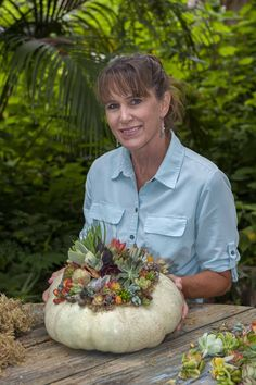 Creating a succulent topped pumpkin for the San Diego Home/Garden Magazine.  November 2012 issue Photo Bob Wigand. Designer Laura Eubanks at Design For Serenity.