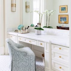 Chic dressing room features a white makeup vanity adorned with brass knobs topped with white marble under a white framed mirror paired with a gray damask vanity chair atop a gray maze tiled floor. Tocador Vanity, Dressing Room Design, Dressing Area, Vanity Stool, Vanity Chairs, Vanity Area, Luxury Interior Design, Luxury Homes, New Homes