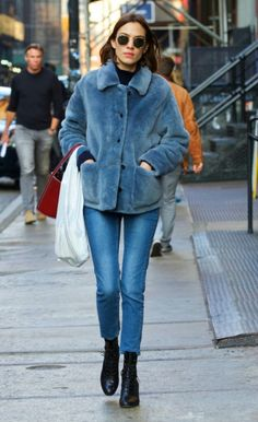 Alexa Chung wears a faux fur collared coat, cropped denim, and booties