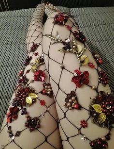 Medias negras de red con flores y lentejuelas