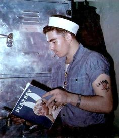 Look at him all stylin' with the sleeves rolled up, and the tattoo, and the cap pushed back,,,