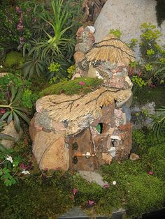 Fairy house - love all the rocks and the thatched roof