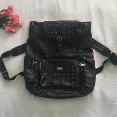 VS PINK Studded Leather Backpack Black leather. Very very light wear and tear. There is only one stud missing and its on the top flap. All zippers are functioning. No grommets are missing at the top where the draw string is. The fabrics is like new, no fading, no cracking and no flaking anywhere. There are no stains on the fabric on the inside. Looking to sell!! Make me an offer! Price is negotiable!!! PINK Victoria's Secret Bags Backpacks