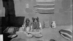 Women(Hopi Tewa) Grinding Corn, Both in Native Dress; Pots, Baskets, and Blankets Nearby 1875 by William Henry Jackson (1843-1942)