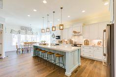 white coastal kitchen with aqua blue island