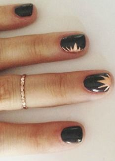 Copper starbursts on black nails