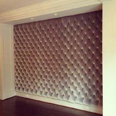 Tufted upholstered wall by Bjork Studio.