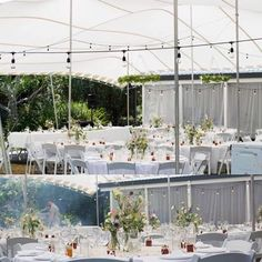 Our white folding chairs look simple and elegant in a stretch tent.