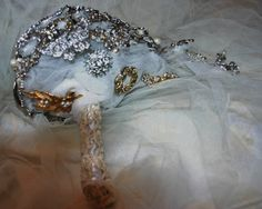 Vintage veil and lace covered handle and  backing , underpinned with random vintage and contemporary  brooches.