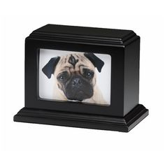 """Keep the memory of your cherished pet close to you, with this 3"""" x 5"""" Photo Frame urn. This elegant birch wood urn has a deep mahogany stain and glass front, and will beautifully frame your favorite pet photo. The urn loads from the base, and closes securely with four screws. It also has felt pads on each corner to prevent furniture scratches."""