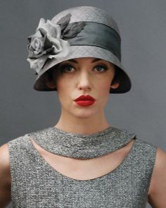 flapper style, I love this hat...I can wear a Cloche Well....Or a Summer straw hat and I have a few.....