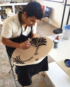 """""""The incredible artist Ahmed who is hand painting every ceramic piece for ecru. #ecru #design #handmade #painting #ceramics #interiors #servingpieces…"""""""